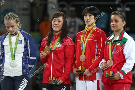 Stock Photo of (l-r) Silver Medalist Mariya Stadnik of Azerbaijan Gold Medalist Eri Tosaka of Japan Bronze Medalists Sun Yanan of China and Elitsa Atanasova Yankova of Bulgaria Poses For a Photo During the Awarding Ceremony of the Women's Freestyle 48kg Game of the Rio 2016 Olympic Games Wrestling Events at the Carioca Arena 2 in the Olympic Park in Rio De Janeiro Brazil 17 August 2016 Brazil Rio De Janeiro