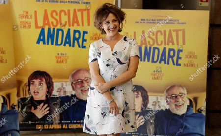 "Italian actress Carla Signoris poses during a photo call for the movie ""Lasciati andare"" in Milan, Italy"