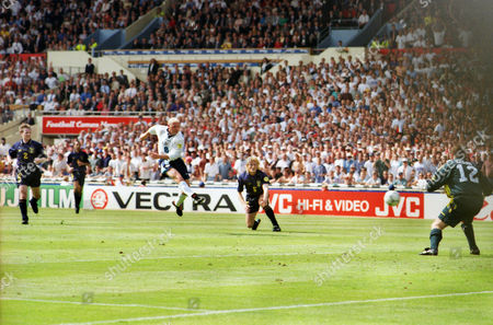 Football - Euro 96 - Group A: England 2 Scotland 0 () Paul Gascoigne scores a brilliant volley past Andy Goram (right) and Colin Hendry. at Wembley.
