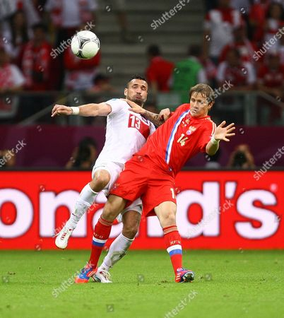 Football - European Championships 2012 - Poland vs. Russia Marcin Wasilewski and Roman Pavlyuchenko of Russia in action at the National Stadium, Warsaw