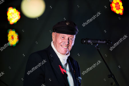 George Montague, known as the Oldest Gay in the Village, speaking on stage at an AIDS memorial candlelit vigil at the close of Manchester Pride in 2014