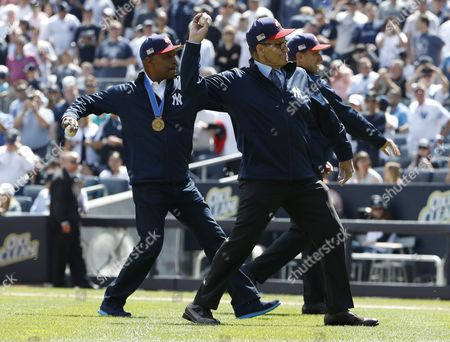 Former New York Yankees' Joe Torre  (C) Willie Randolph (L) and Tino Martinez (R) throw out the first pitch before the game between the New York Yankees and the Tampa Bay Rays during the New York Yankees home Opening game game at Yankee Stadium in the Bronx, New York, USA, 10 April 2017.