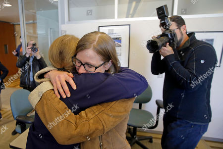 Jessica Miller, Erin Alberty Pulitzer winners from the Salt Lake Tribune, Jessica Miller, left, and Erin Alberty hug during a Pulitzer party in their newsroom, in Salt Lake City. The Salt Lake Tribune staff won for reports revealing the mistreatment of sexual assault victims at Brigham Young University