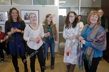 Pulitzer winners, left to right, Rachel Piper, Jessica Miller, Erin Alberty, Alex Stuckey and Sheila McCann from the Salt Lake Tribune, look on during a Pulitzer party in their newsroom, in Salt Lake City. The Salt Lake Tribune staff won for reports revealing the mistreatment of sexual assault victims at Brigham Young University