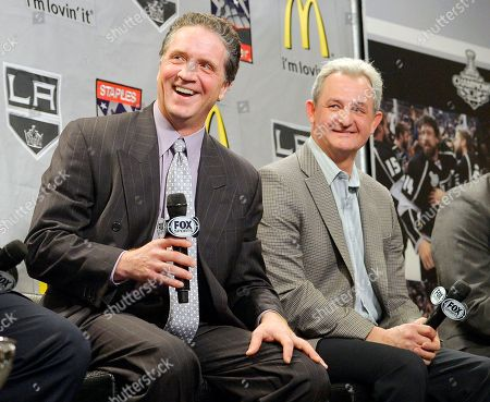 Tim Leiweke, Dean Lombardi, Luc Robitaille, Darryl Sutter Shows Los Angeles Kings president and general manager Dean Lombardi and head coach Darryl Sutter laughing during a news conference to help kick off the NHL hockey team's season in Los Angeles. The Kings have fired Sutter and Lombardi, who led the franchise to its only two Stanley Cup championships. On, the team also promoted former defenseman Rob Blake to vice president and general manager, while longtime executive Luc Robitaille will be their new team president in charge of all hockey and business operations