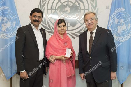 Stock Photo of Secretary-General Antonio Guterres (right) meets with Malala Yousafzai, her father, Ziauddin Yousafzai.