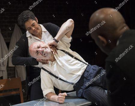 Stock Image of Sara Powell as Dr Rieux, Joe Alessi as Mr Cottard, Burt Caesar as Grand