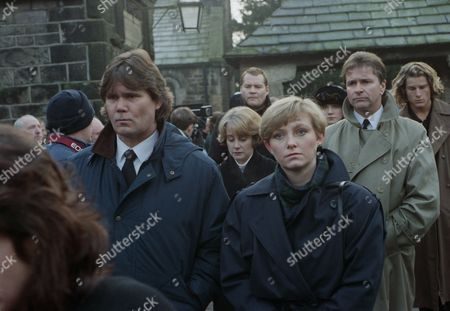 It is the day of the funerals for the plane crash victims. The burials take place - with Lynn Whiteley, as played by Fionnuala Ellwood and Gavin Watson, as played by Ben Robertson. (Ep 1836 - 20th January 1994).