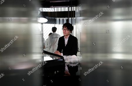 On, Japan designer Oki Sato sits during an interview at the Panerai space, part of the Design Fair exhibition, in Milan, Italy