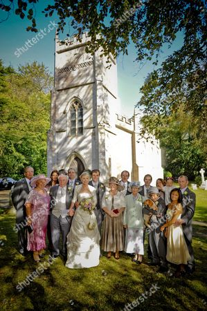 Sarah Ayton and Nick Dempsey with guests outside the church