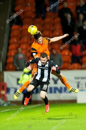 Dundee United forward Thomas Mikkelsen (#18) rises above Dunfermline Athletic forward Paul McMullan (#18) to win a header during the Ladbrokes Scottish Championship match between Dundee United and Dunfermline Athletic at Tannadice Park, Dundee