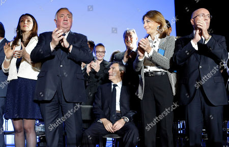 Francois Fillon, Valerie Boyer, Gerard Larcher, Eric Ciotti, Martine Vassal French conservative presidential candidate Francois Fillon, center, sits while deputy Valerie Boyer, left, President of the Senate Gerard Larcher, second left, deputy Eric Ciotti, right, Martine Vassal President of Departmental Council, applaud, before his speech during a campaign meeting in Marseille, southern France, Tuesday, April, 11, 2017. The two-round presidential election is set for April 23 and May 7