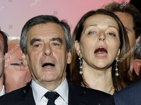 Francois Fillon, Boyer French conservative presidential candidate Francois Fillon and Valerie Boyer, sing the national anthem during a campaign meeting in Marseille, southern France, Tuesday, April, 11, 2017. The two-round presidential election is set for April 23 and May 7