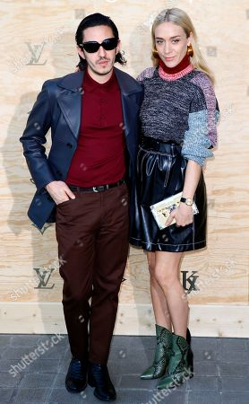 Stock Image of Ricky Saiz and Chloe Sevigny pose during a photocall ahead of a diner for the launch of a Louis Vuitton leather goods collection in collaboration with US artist Jeff Koons, at the Louvre Museum in Paris