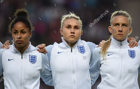 Demi Stokes, Isobel Christiansen and Laura Bassett of England  stand for national anthems during the Womens International friendly match between England and Austria played at Stadium MK, Milton Keynes on 10th April 2017