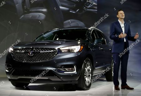 Stock Photo of Buick Global Vice President Duncan Aldred speaks as the 2018 Buick Enclave is displayed at the New York International Auto Show, in New York