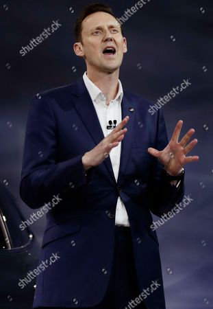 Buick Global Vice President Duncan Aldred speaks as the 2018 Buick Enclave Avenir is displayed at the New York International Auto Show, in New York
