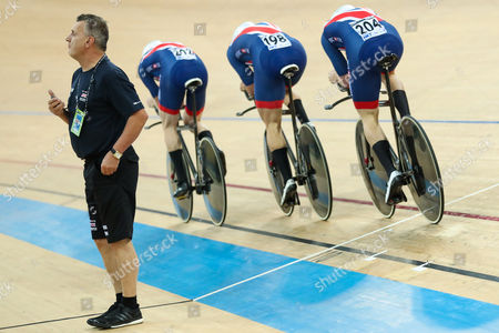 Stock Image of Great Britain coach Heiko Salzwedel watches on as Steven Burke (not pictured), Ollie Wood, Andy Tennant and Kian Emadi compete in the Men's Team Pursuit qualifying.