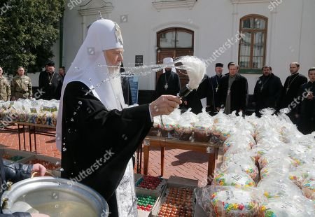 The head of the Ukrainian Orthodox Church Patriarch Filaret blesses traditional Easter cakes and painted eggs prepared for soldiers on front line on Eastern Ukraine for Easter celebrations in Kiev, Ukraine