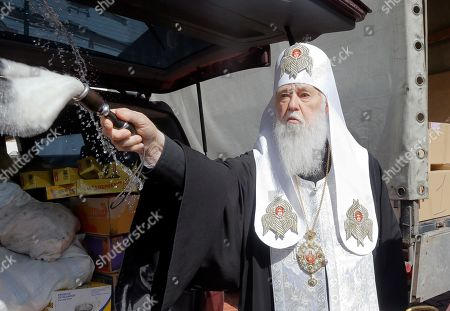 The head of the Ukrainian Orthodox Church Patriarch Filaret blesses gifts prepared for soldiers on front line on Eastern Ukraine for Easter celebrations in Kiev, Ukraine