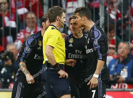 Cristiano Ronaldo of Real Madrid argues with referee Mr Nicola Rizzoli after he awarded a penalty kick to Bayern Munich during the UEFA Champions League Quarter-Final 1st Leg match between Bayern Munich and Real Madrid played at the Allianz Arena, Munich, on 12th April 2017