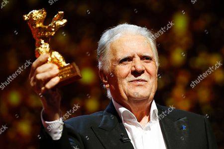 German cinematographer Michael Ballhaus shows the Honorary Golden Bear after being awarded for his lifetime achievement during the awarding ceremony at the 2016 Berlinale Film Festival in Berlin, Germany. Ballhaus has died. He was 81