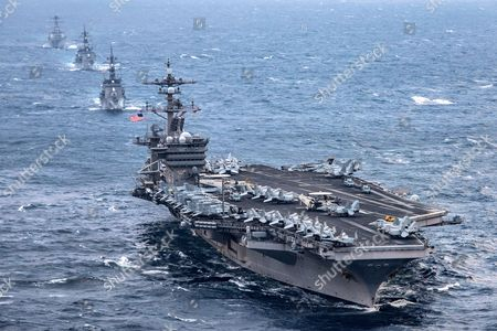 The aircraft carrier USS Carl Vinson (CVN 70), foreground, transits the East China Sea with the Japan Maritime Self-Defense Force Takanami-class destroyer JS Sazanami (DD 113), middle first, the Japan Maritime Self-Defense Force Murasame-class destroyer JS Samidare (DD 106), middle second, and the Arleigh Burke-class guided-missile destroyer USS Wayne E. Meyer (DDG 108). The Carl Vinson Carrier Strike Group is on a regularly scheduled Western Pacific deployment as part of the U.S. Pacific Fleet-led initiative to extend the command and control functions of U.S. 3rd Fleet. U.S. Navy aircraft carrier strike groups have patrolled the Indo-Asia-Pacific regularly and routinely for more than 70 years.