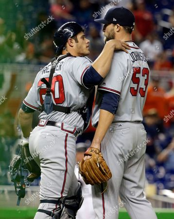 Anthony Recker, Jim Johnson Atlanta Braves catcher Anthony Recker (20) and relief pitcher Jim Johnson (53) celebrate after defeating the Miami Marlins during a baseball game, in Miami. The Braves won 5-4