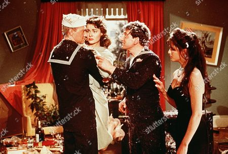 Stock Image of 'Upstairs and Downstairs'  Film - 1959 -      With pillow feather floating about Kate Barry (Anne Heywood) intervenes between the two drunken american sailors (Bill Edwards and Gaylord Cavallaro) as Maria (Claudia Cardinale ) right, looks on.