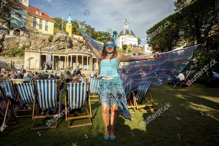 Stock Photo of Festival No 6, Gwynedd, Music Festival, North Wales, Number 6, Portmeirion, Sam Lee, The Village, UK, Wales, crowd, deck chairs, fancy dress, festival, festivalgoers, gypsy, mask, siren, talk, wings