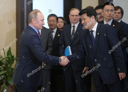 Vladimir Putin and Nur Bekri