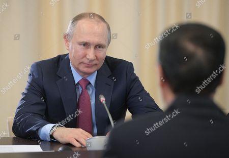 Vladimir Putin and Zhang Gaoli
