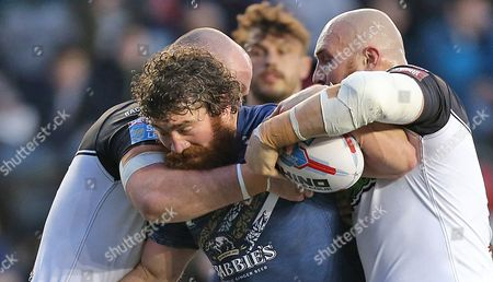 Stock Image of St's KYLE AMOR TRIES TO PASS Widnes JACK BUCHANAN AND Widnes GIL DUDSON Pix Magi Haroun 21.04.2017 RUGBY SUPERLEAGUE ROUND 10 WIDNES VIKINGS V ST HELENS