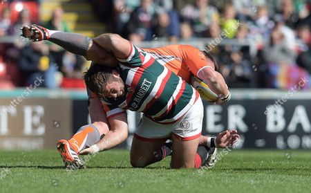 Leicester's Jack Roberts tackles Newcastle's David Wilson who tumbles over the top - Rugby Union - Leicester Tigers V Newcastle Falcons - Aviva Premiership - 15/04/17 - at Welford Road Leicester UK. Photo Credit - Tom Dwyer/Seconds Left Images