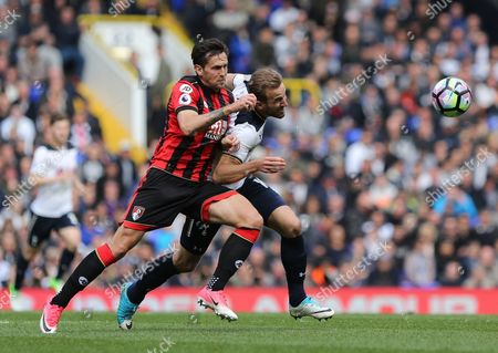 Harry Kane of Spurs with Charlie Daniels of Bournemouth