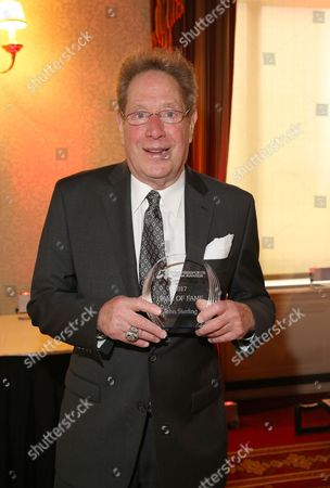 John Sterling, New York Yankees announcer, receives the Hall of Fame award at the Cynopsis Sports Media Awards Breakfast,, in New York