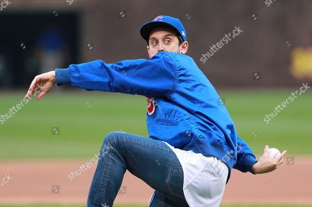 Stock Photo of Actor Brad Morris throws a ceremonial first pitch before a baseball game between the Chicago Cubs and the Los Angeles Dodgers in Chicago, on