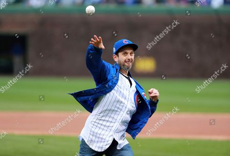 Actor Brad Morris throws a ceremonial first pitch before a baseball game between the Chicago Cubs and the Los Angeles Dodgers in Chicago, on