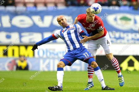 Stock Picture of Gabriel Obertan competes with Marc Roberts during the SKY BET Championship match between Wigan Athletic and Barnsley played at the DW Stadium, Wigan on 13th April, 2017