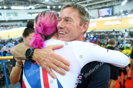 Great Britain's Katie Archibald (L) celebrates with British Cycling's new Performance Director Stephen Park (R) after winning the Women's Omnium.