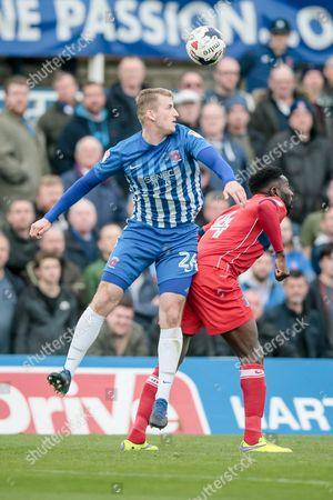 Scott Harrison (Hartlepool United) wins the header against Jabo Ibehre (Carlisle United) during the EFL Sky Bet League 2 match between Hartlepool United and Carlisle United at Victoria Park, Hartlepool