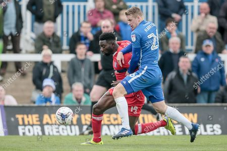 Scott Harrison (Hartlepool United) and Jabo Ibehre (Carlisle United) fight for the ball during the EFL Sky Bet League 2 match between Hartlepool United and Carlisle United at Victoria Park, Hartlepool