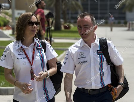 Paddy Lowe (R) technical Chief of Williams Formula One team and Claire Williams (L), deputy team principal walk down the paddock of the Sakhir circuit near Manama, Bahrain, 14 April 2017. The 2017 Formula One Grand Prix of Bahrain will take place on 16 April 2017.