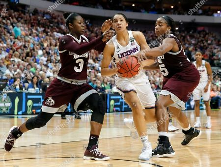 Stock Image of Gabby Williams, Breanna Richardson, Chinwe Okorie Mississippi State's Breanna Richardson (3) and Chinwe Okorie, right, defend against a drive to the basket by Connecticut's Gabby Williams (15) during an NCAA college basketball game in the semifinals of the women's Final Four, in Dallas