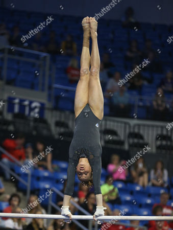 UCLA's Madison Kocian does a handstand on the bars during the Semifinals of the NCAA Women's National Collegiate Gymnastics Championships at the Chaifetz Arena in St. Louis, MO