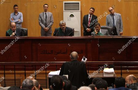 Stock Image of Egyptian Judges attend the trial of Alaa and Gamal Mubarak, the sons of former former president Hosni Mubarak during their trial in ''Stock Market Manipulation'' case, in Cairo, Egypt