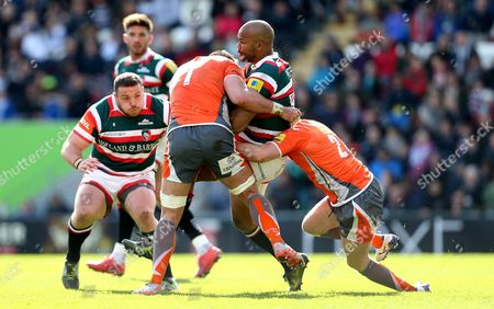 JP Pietersen of Leicester Tigers is tackled by Will Welch of Newcastle Falcons and Callum Chick of Newcastle Falcons