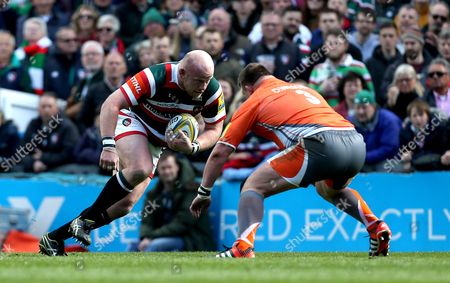 Dan Cole of Leicester Tigers takes on David Wilson of Newcastle Falcons