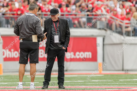 th, Honorary coach Phil Knight shakes hands with Ohio State Buckeyes head coach Urban Meyer during a short time out of the Ohio State Buckeyes Life Sports spring game presented by Nationwide at Ohio Stadium, Columbus, OH