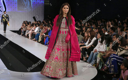 A model presents a creation by designer Ali Xeeshan during the Fashion Week organized by the Pakistan Fashion Design Council in Lahore, Pakistan